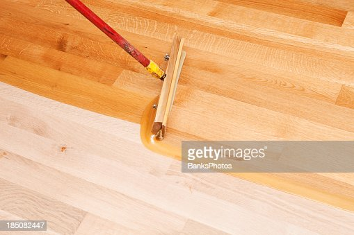 Applying Polyurethane To Hardwood Floors polyurethane wood floors houses flooring picture ideas blogule Squeegee Style Brush Applying Clear Polyurethane To Hardwood Floor Stock Photo