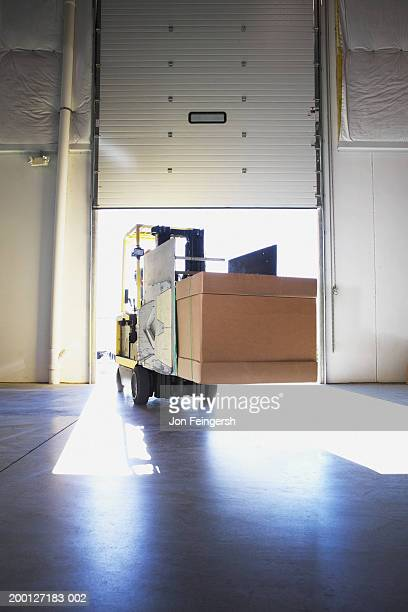 Squeeze with boxes entering warehouse