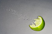 squeezed lime wedge with spray droplets