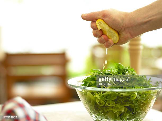 Squeezing Lemon On To Salad
