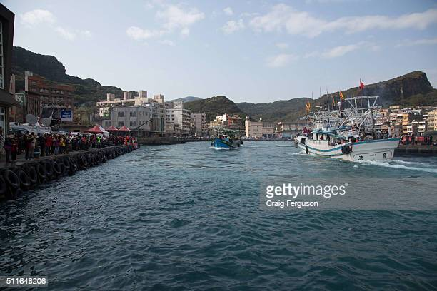 Squid boats from a harbour fishing fleet let off fireworks as they circle the harbour opposite the Baoan Temple in a harbour cleansing ritual Each...