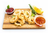 squid in batter sauces with spices, on white background