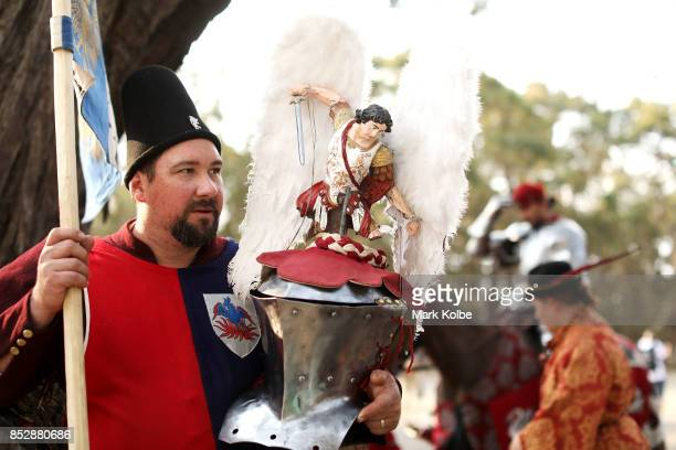 A squire hold the decorated helmet of Michael Sadde of France as he prepares to compete in the World Jousting Championships against on September 24...