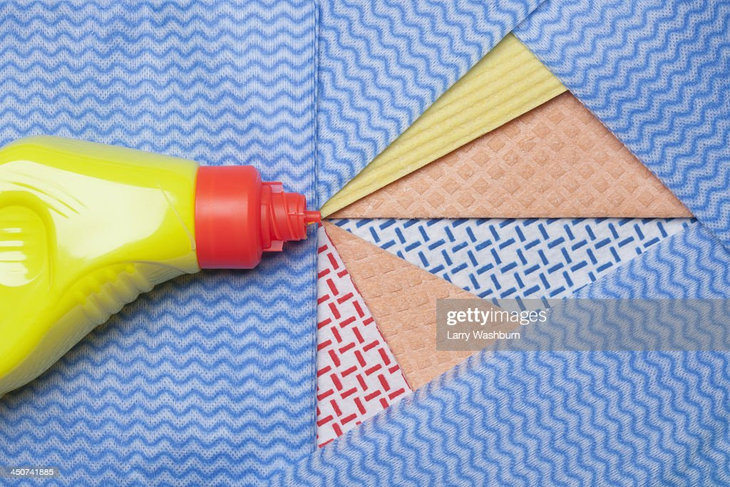 Squirt of a household cleaner represented by segmented cut-outs of dishcloths : Stock Photo