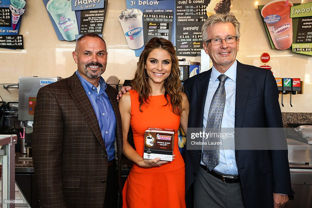 Sr. vice president /brand officer of Baskin-Robbins Bill Mitchell, actress <a gi-track='captionPersonalityLinkClicked' href=/galleries/search?phrase=Maria+Menounos&family=editorial&specificpeople=203337 ng-click='$event.stopPropagation()'>Maria Menounos</a> and CEO of Dunkin' brands / president of Dunkin' Donuts Nigel Travis attend the launch of Dunkin' Donuts K-Cups at Baskin-Robbins on October 4, 2012 in Burbank, California.