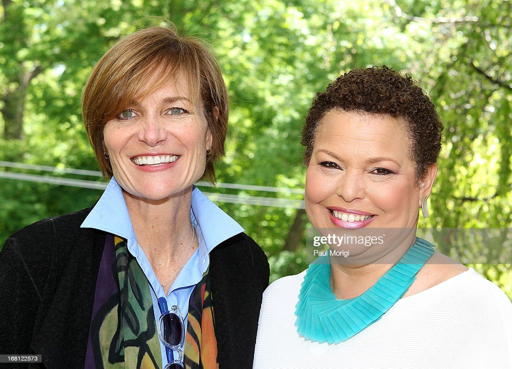 Sr. Vice President of the GRAMMY Foundation Kristen Madsen (L) and Debra Lee, Chairman & CEO, BET Networks, pose for a photo at the GRAMMY Foundation - Debra Lee house concert with Esperanza Spalding at Private Residence on May 5, 2013 in Washington, DC.