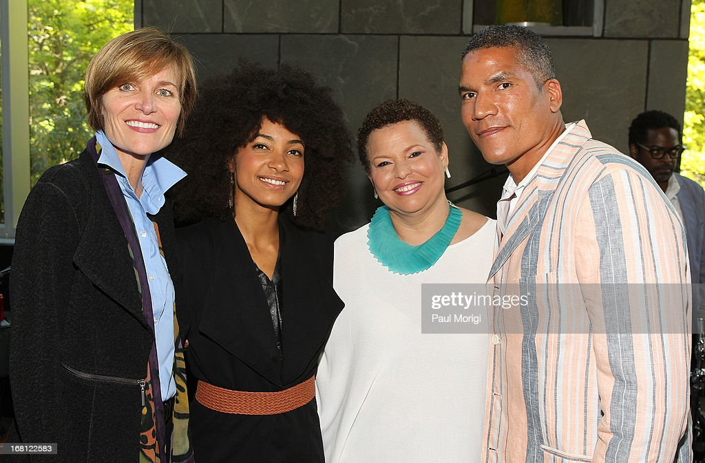 Sr. Vice President of the GRAMMY Foundation Kristen Madsen, performer and 3-time GRAMMY Award winner Esperanza Spalding, Debra Lee, Chairman & CEO, BET Networks, and Paxton K. Baker, Executive Vice President and General Manager of Centric, pose for a photo at the GRAMMY Foundation - Debra Lee house concert with Esperanza Spalding at Private Residence on May 5, 2013 in Washington, DC.