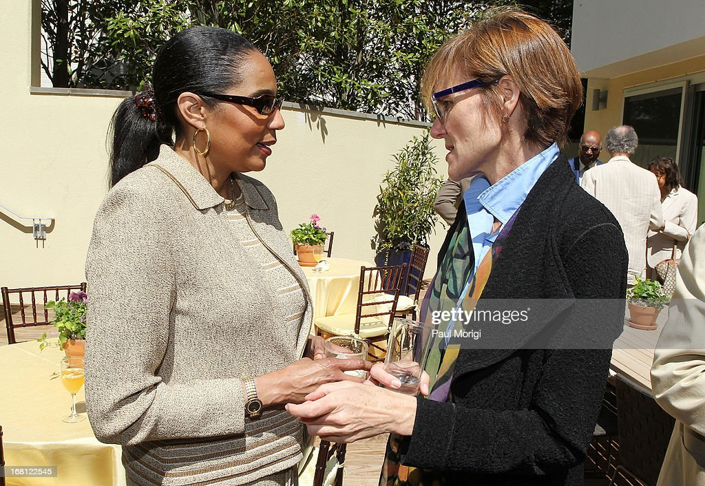 Sr. Vice President of the GRAMMY Foundation Kristen Madsen (R) talks with Shuanise Washington, President and CEO at Congressional Black Caucus Foundation, at the GRAMMY Foundation - Debra Lee house concert with Esperanza Spalding at Private Residence on May 5, 2013 in Washington, DC.