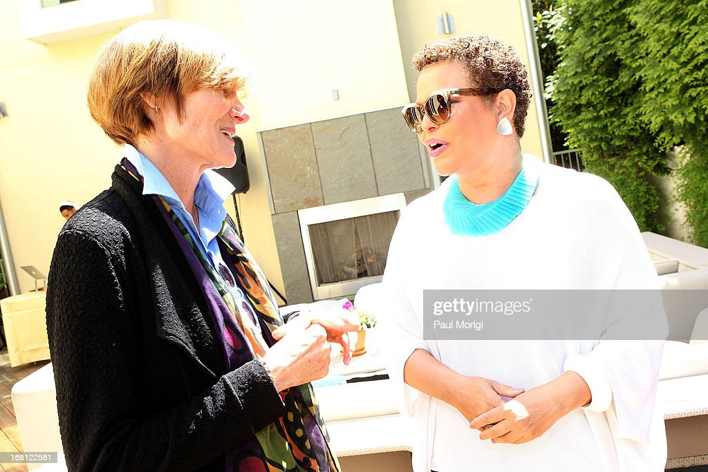 Sr. Vice President of the GRAMMY Foundation Kristen Madsen (L) talks with Debra Lee, Chairman & CEO, BET Networks, at the GRAMMY Foundation - Debra Lee house concert with Esperanza Spalding at Private Residence on May 5, 2013 in Washington, DC.