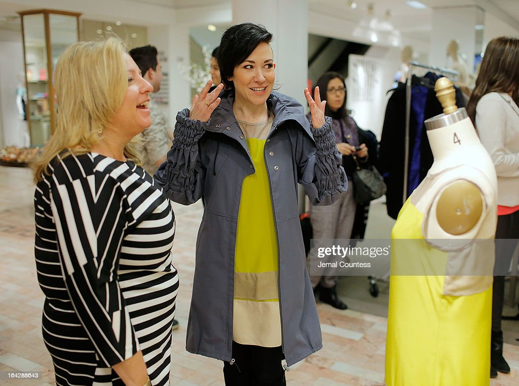 Sr. VP and General Merchandise Manager MaryAnn Morin and designer Michelle Franklin with Michelle's Project Runway Lord & Taylor challenge winning design during an in-store visit to the Lord & Taylor Flagship store on March 22, 2013 in New York City.