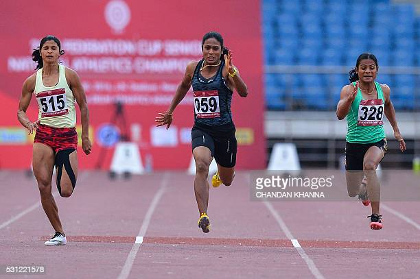 Srabani Nanda of Odisha Jyothi HM of Canara Bank and Dutee Chand of Odisha take part in the 100 metre race during 20th Federation Cup National Senior...