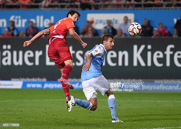 Srdan Lakic of Kaiserslautern scores his team's second goal against Guillermo Vallori of 1860 Muenchen during the Second Bundesliga match between 1...