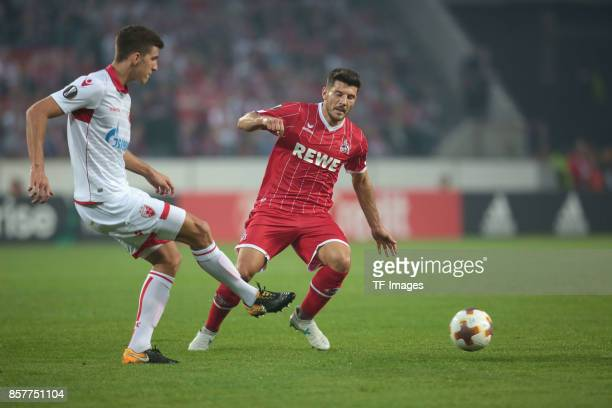 Srdjan Babic of Belgrad and Milos Jojic of Koeln battle for the ball during the UEFA Europa League group H match between 1 FC Koeln and Crvena Zvezda...