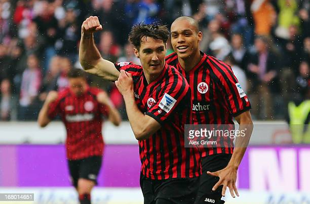Srdjan Lakic of Frankfurt celebrates his team's second goal with team mate Bamba Anderson during the Bundesliga match between Eintracht Frankfurt and...