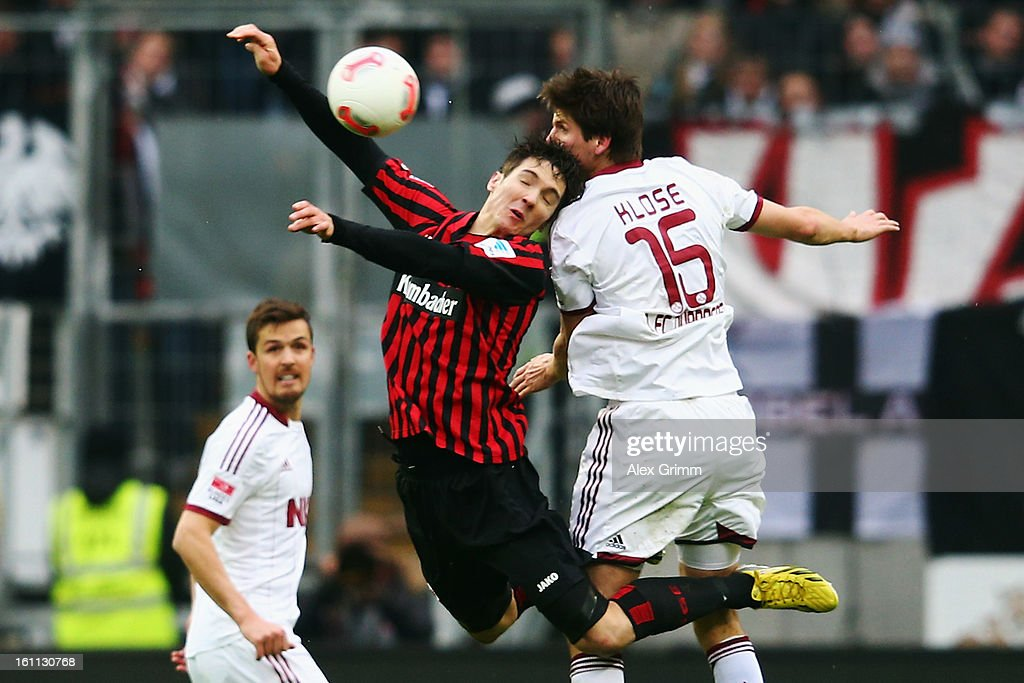 <a gi-track='captionPersonalityLinkClicked' href=/galleries/search?phrase=Srdjan+Lakic&family=editorial&specificpeople=1792938 ng-click='$event.stopPropagation()'>Srdjan Lakic</a> (L) of Frankfurt jumps for a header with <a gi-track='captionPersonalityLinkClicked' href=/galleries/search?phrase=Timm+Klose&family=editorial&specificpeople=7864194 ng-click='$event.stopPropagation()'>Timm Klose</a> of Nuernberg during the Bundesliga match between Eintracht Frankfurt and 1. FC Nuernberg at Commerzbank-Arena on February 9, 2013 in Frankfurt am Main, Germany.