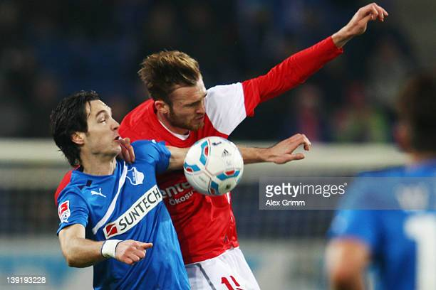 Srdjan Lakic of Hoffenheim is challenged by Jan Kirchhoff of Mainz during the Bundesliga match between 1899 Hoffenheim and FSV Mainz 05 at...