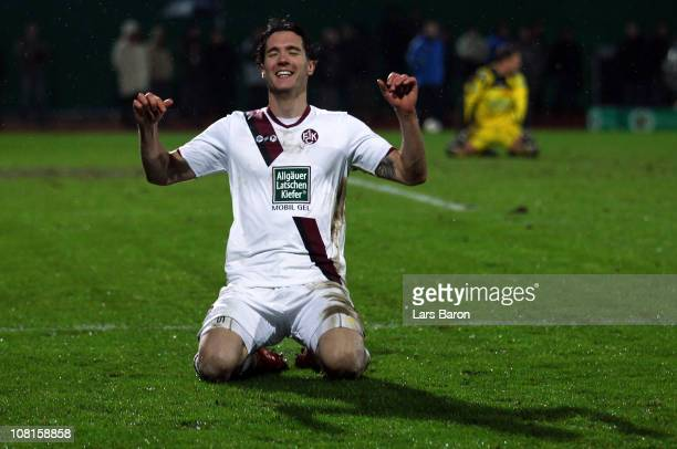 Srdjan Lakic of Kaiserslautern celebrates after scoring his teams fourth and his third goal during the DFB Cup round of sixteen match between TuS...