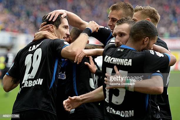 Srdjan Lakic of Paderborn celebrates with team mates after scoring his team's second goal during the Bundesliga match between SC Paderborn 07 and FC...
