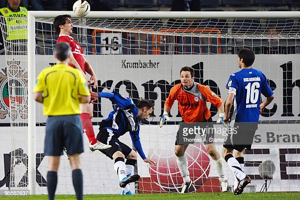 Srdjan Lakic scores his team's second goal against Zlatko Janjic Dennis Eilhoff and Andre Mijatovic of Bielefeld during the Second Bundesliga match...