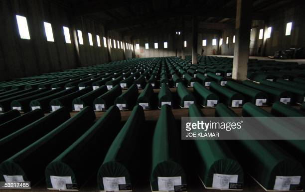Caskets with remains of 610 Bosnian Muslims that just arrived at the former battery factory in Potocari near the eastern Bosnian town of Srebrenica...