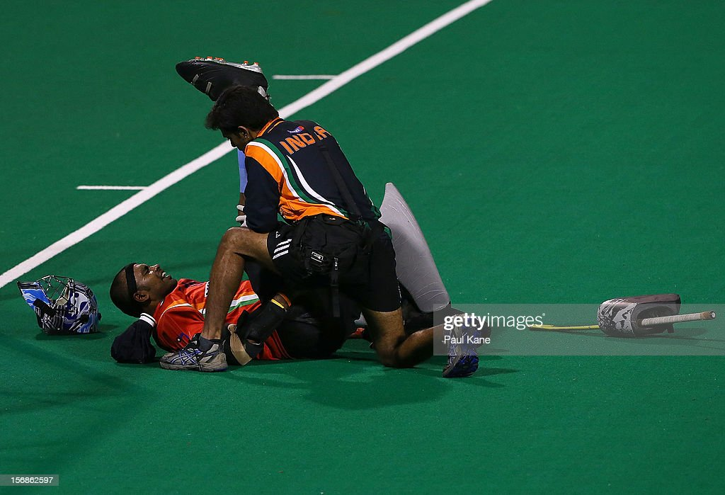 P.R. Sreejesh of India receives treatment on field in the mens Australia Kookaburras v India game during day two of the 2012 International Super Series at Perth Hockey Stadium on November 23, 2012 in Perth, Australia.