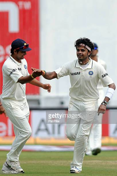 Sreesanth of India celebrates the wicket of Ben Hilfenhaus with teammate Suresh Raina during day five of the Second Test match between India and...