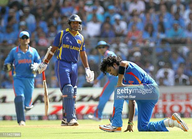 Sreesanth of India feels the heat during the 2011 ICC World Cup Final between India and Sri Lanka at Wankhede Stadium on April 2 2011 in Mumbai India