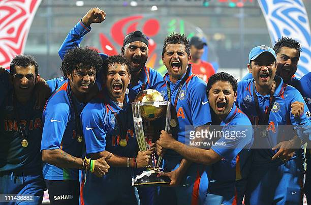 Sreesanth Sachin Tendulkar Harbhajan Singh Suresh Raina Piyush Chawla and Virender Sehwag of India celebrate their teams win against Sri Lanka during...