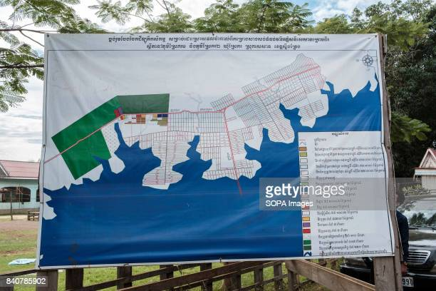 Srekor village will be affected by the flooding of the Lower Sesan II Dam This map outside the villages pergoda shows the extent of the flooding and...