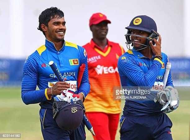 Sri Lanka batsman Dhananjaya De Silva and teammate Kusal Mendis walk off the pitch after their victory in the opening match of the ODI series Sri...