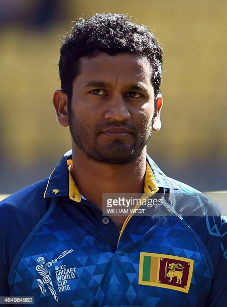 Sri Lanka batsman Dimuth Karunaratne stands for the national anthem before the start of the England versus Sri Lanka 2015 Cricket World Cup Group A...