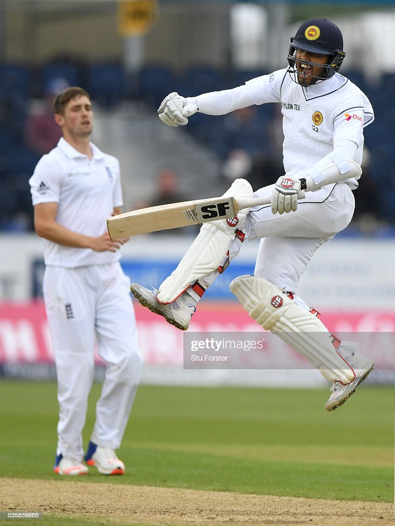 Sri Lanka batsman <a gi-track='captionPersonalityLinkClicked' href=/galleries/search?phrase=Dinesh+Chandimal&family=editorial&specificpeople=4884949 ng-click='$event.stopPropagation()'>Dinesh Chandimal</a> celebrates his century as Chris Woakes looks on during day four of the 2nd Investec Test match between England and Sri Lanka at Emirates Durham ICG on May 30, 2016 in Chester-le-Street, United Kingdom.