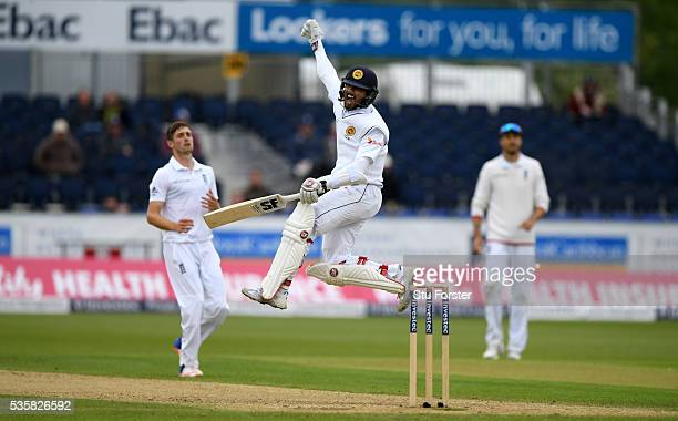 Sri Lanka batsman Dinesh Chandimal celebrates his century during day four of the 2nd Investec Test match between England and Sri Lanka at Emirates...