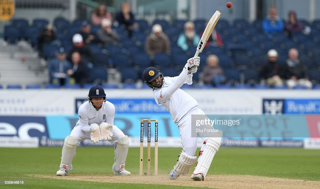 Sri Lanka batsman <a gi-track='captionPersonalityLinkClicked' href=/galleries/search?phrase=Dinesh+Chandimal&family=editorial&specificpeople=4884949 ng-click='$event.stopPropagation()'>Dinesh Chandimal</a> hits out watched by Jonny Bairstow during day four of the 2nd Investec Test match between England and Sri Lanka at Emirates Durham ICG on May 30, 2016 in Chester-le-Street, United Kingdom.