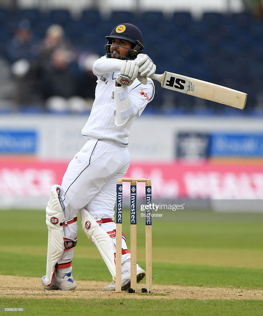 Sri Lanka batsman <a gi-track='captionPersonalityLinkClicked' href=/galleries/search?phrase=Dinesh+Chandimal&family=editorial&specificpeople=4884949 ng-click='$event.stopPropagation()'>Dinesh Chandimal</a> pulls a ball to the boundary during day four of the 2nd Investec Test match between England and Sri Lanka at Emirates Durham ICG on May 30, 2016 in Chester-le-Street, United Kingdom.