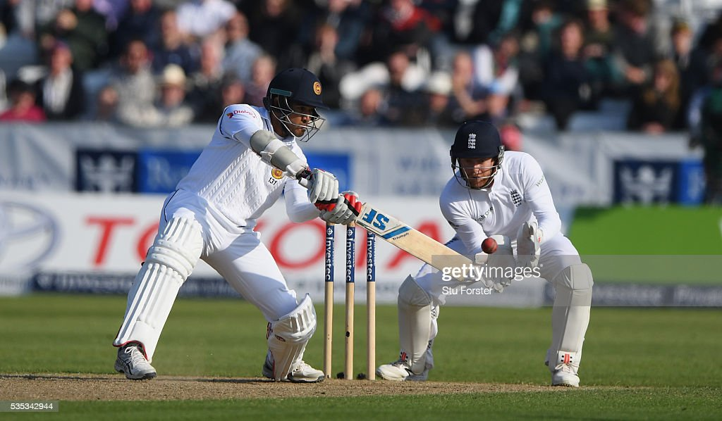 Sri Lanka batsman Milinda Siriwardana hits out as Jonny Bairstow looks on during day three of the 2nd Investec Test match between England and Sri Lanka at Emirates Durham ICG on May 29, 2016 in Chester-le-Street, United Kingdom.