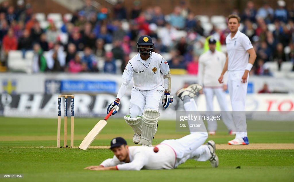 Sri Lanka batsman Nuwan Pradeep makes his ground as Steven Finn dives in his attempt to back up during day three of the 2nd Investec Test match between England and Sri Lanka at Emirates Durham ICG on May 29, 2016 in Chester-le-Street, United Kingdom.