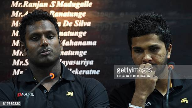 Sri Lanka captain Angelo Mathews and Dinesh Chandimal look on during a press conference in Colombo on October 24 2016 Sri Lanka's oldest ever skipper...