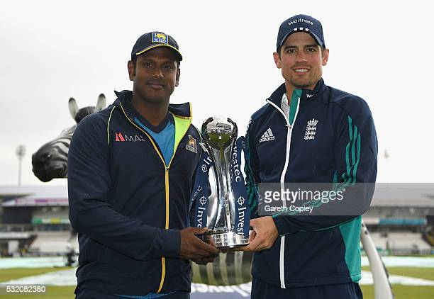 Sri Lanka captain Angelo Mathews and England captain Alastair Cook poses with Investec test series trophy at Headingley on May 18 2016 in Leeds...