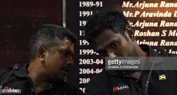 Sri Lanka captain Angelo Mathews and Sri Lanka's oldest ever skipper Rangana Herath speak at a press conference in Colombo on October 24 2016 Sri...