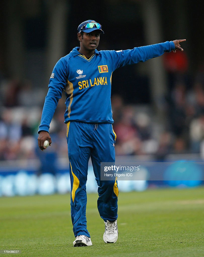 Sri Lanka captain Angelo Mathews directs his fielders during the ICC Champions Trophy group A match between England and Sri Lanka at The Kia Oval on June 13, 2013 in London, England.