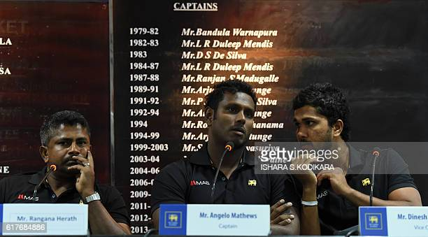 Sri Lanka captain Angelo Mathews Sri Lanka's oldest ever skipper Rangana Herath and Dinesh Chandimal look on during a press conference in Colombo on...