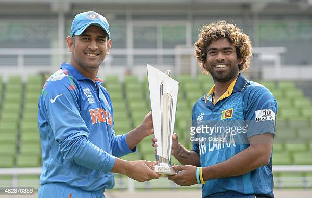 Sri Lanka captain Lasith Malinga and India captain Mahendra Singh Dhoni pose with the ICC World Twenty20 trophy ahead of tomorrow's final at...