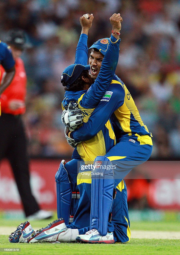 Sri Lanka celebrate after Shaun Marsh was run out by <a gi-track='captionPersonalityLinkClicked' href=/galleries/search?phrase=Tillakaratne+Dilshan&family=editorial&specificpeople=239186 ng-click='$event.stopPropagation()'>Tillakaratne Dilshan</a> during game one of the Twenty20 international match between Australia and Sri Lanka at ANZ Stadium on January 26, 2013 in Sydney, Australia.