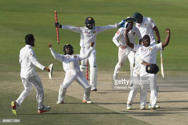 Sri Lanka celebrates taking the final wicket of Mohammad Abbasto win the First Test between Pakistan and Sri Lanka at Sheikh Zayed stadium on October...