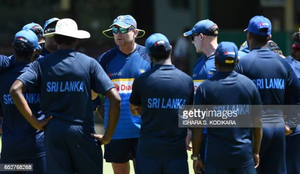 Sri Lanka coach Graham Ford chats with team members during a practice session at The P Sara Oval Cricket Stadium in Colombo on March 13 2017...
