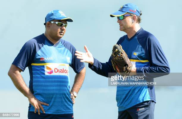 Sri Lanka coach Graham Ford speaks with newly appointed Sri Lankan cricket manager Asanka Gurusinghe during a practice session at the Galle...