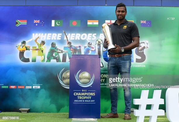 Sri Lanka cricket captain Angelo Mathews poses with The ICC Champions Trophy in Colombo on March 23 2017 The ICC Champions Trophy is a one day...
