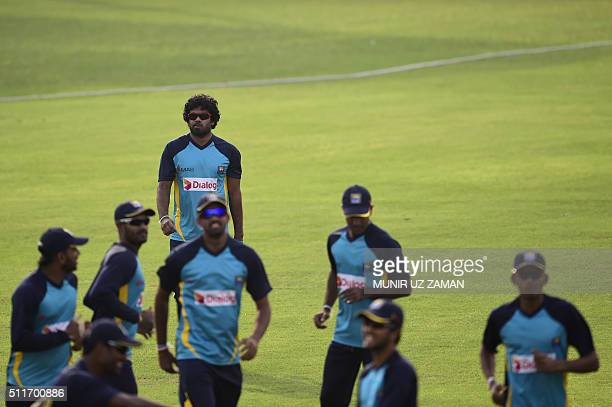 Sri Lanka cricket captain Lasith Malinga and teammates train at the Khan Shaheb Osman Ali Stadium in Fatullah on February 23 2016 AFP PHOTO/Munir uz...
