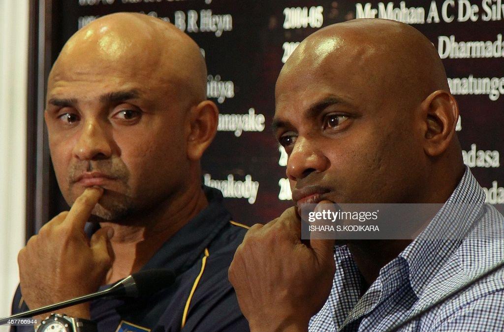 Sri Lanka cricket coach Marvan Atapattu and chief cricket selector Sanath Jayasuriya react during a press conference in Colombo on March 27 2015...